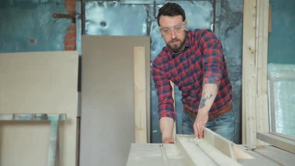 Worker in a carpentry workshop
