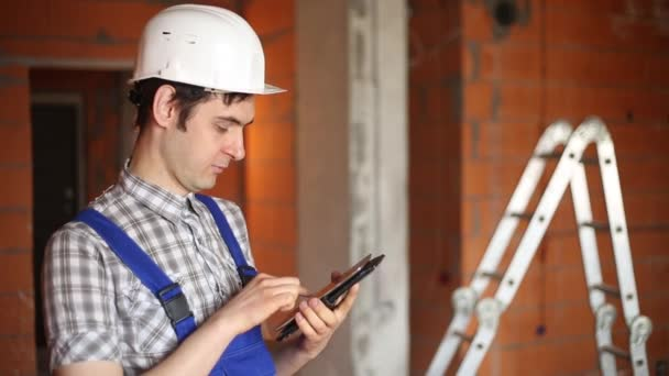 A civil engineer conducts economic calculations on the tablet