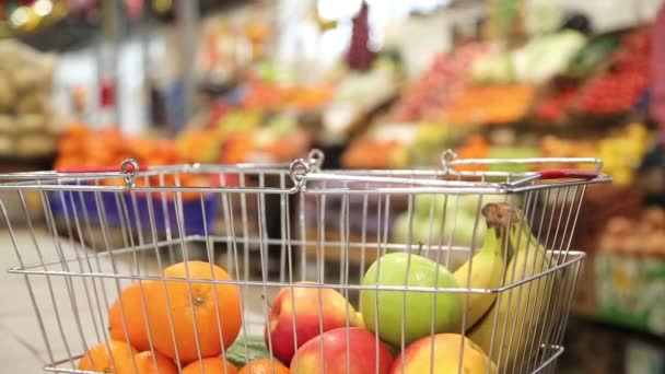 Shopping cart with fruit on the background of the market