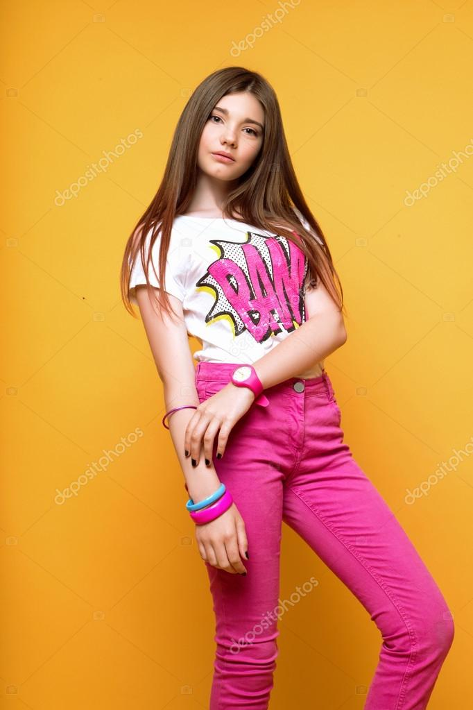 A Beautiful 13-years Old Girl Dressed In Pink Pants And A