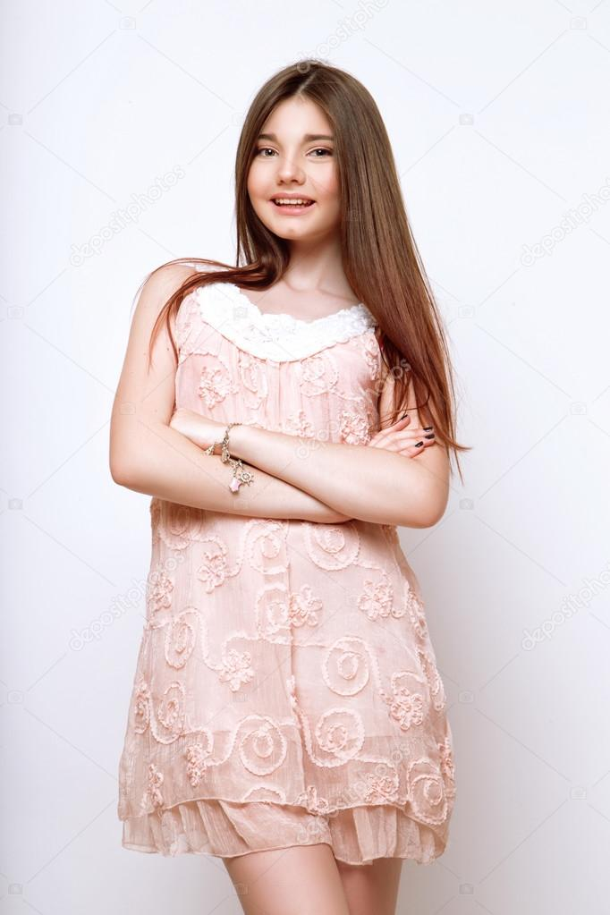 A Beautiful 13-years Old Girl Dressed In Pink Dress In