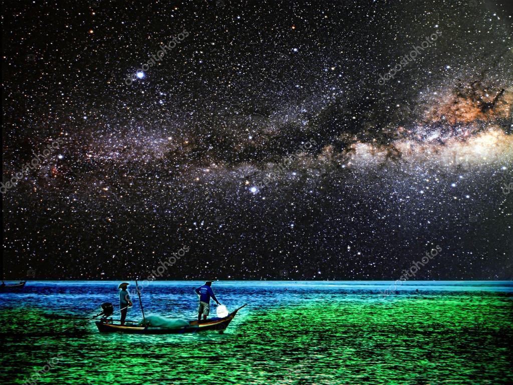 Fishing boat on horizon line between sky and ocean