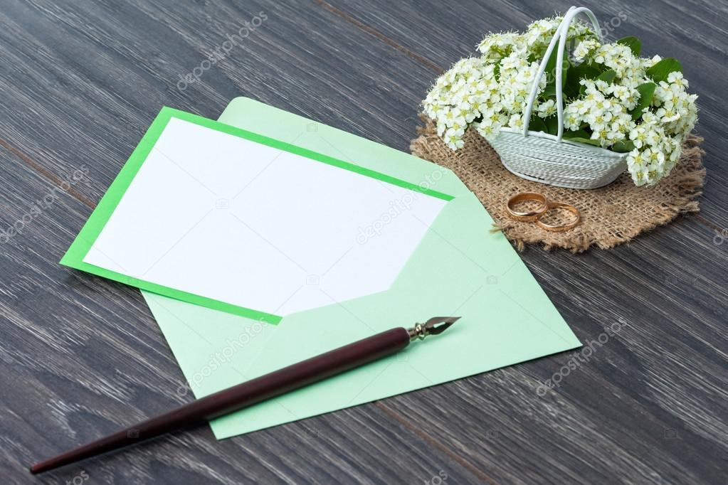 Flowers and envelope on wooden background