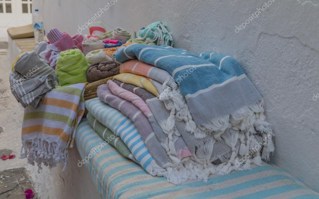 big pile of summer style linen stack of and rolls of different