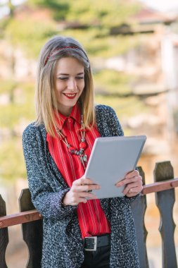 Young business woman using tablet outdoor