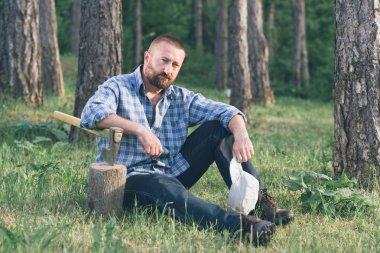 Lumberjack in forest.