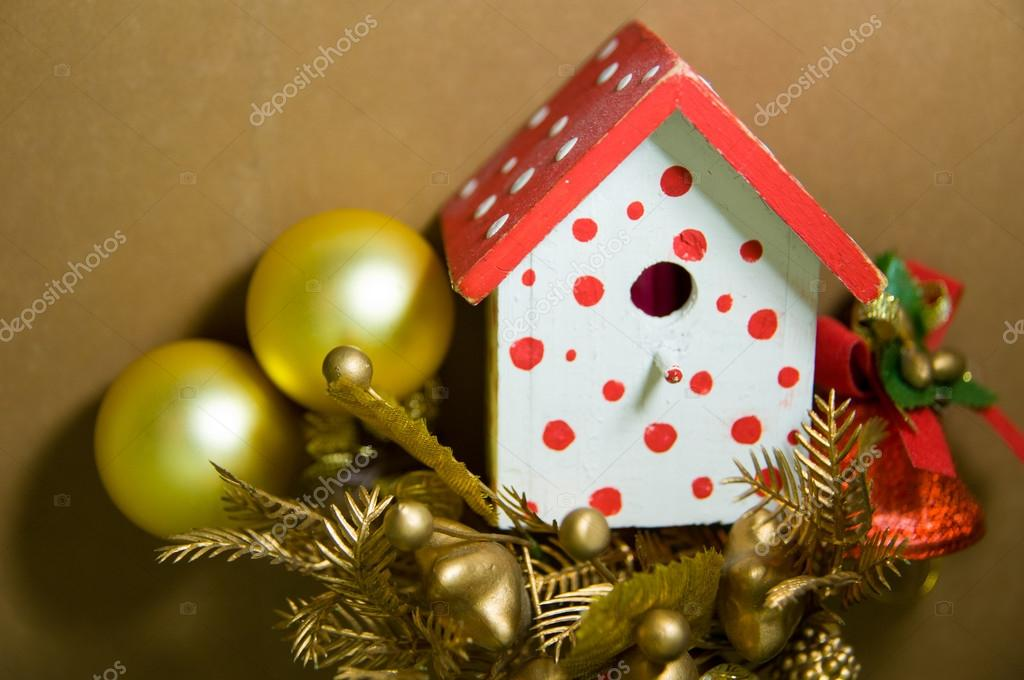 bird house christmas tree decorations on a brown background with christmas balls christmas bell and other decorations photo by dmitryukomarovgmailcom - Bird House Christmas Decoration