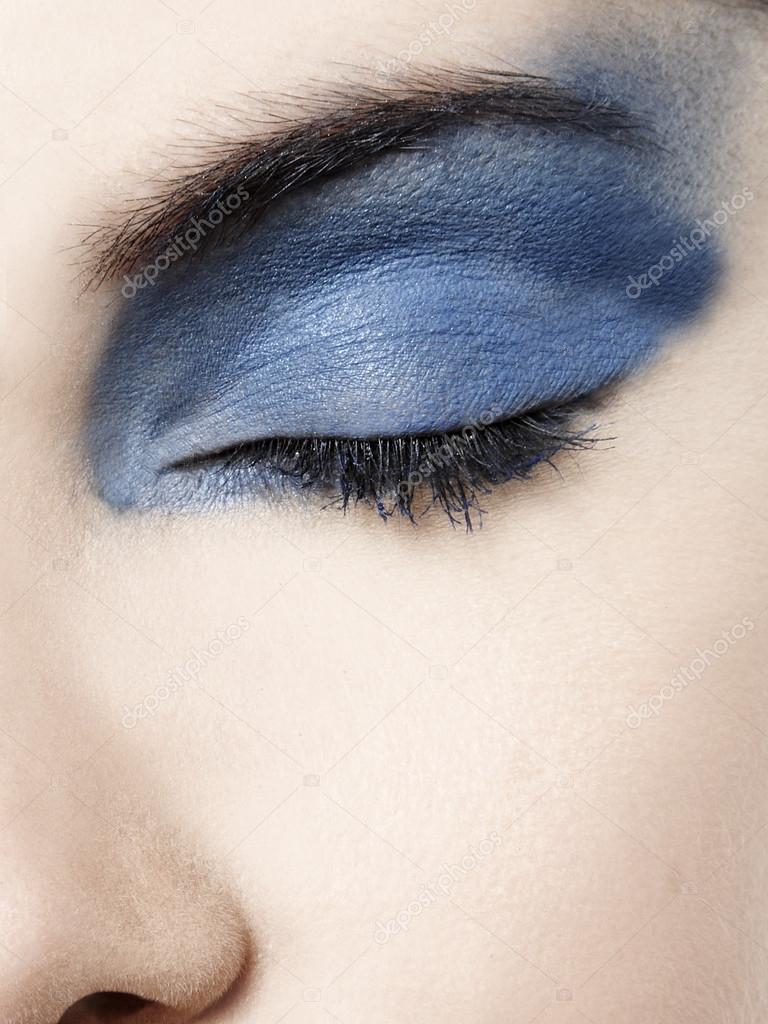 woman eye with blue eyeshadow