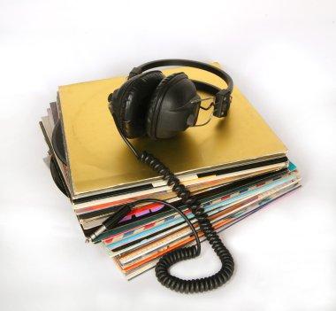 Vintage headphones on a stack of old vinyls
