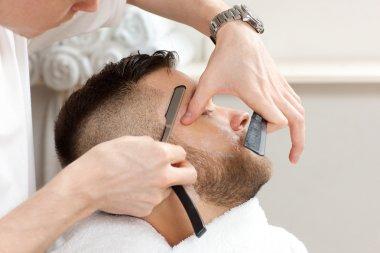 barber to trim the hair straight razor