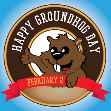 Cute groundhog popping out of a hole.