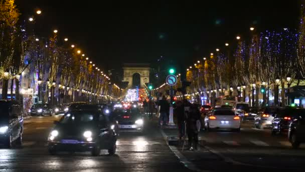A View on Champs Elysee Avenue in Paris, France at night