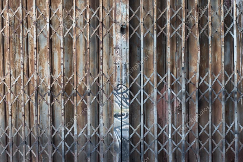 Asian rusty folding doors or traditional gate. Old steel rusty door ...