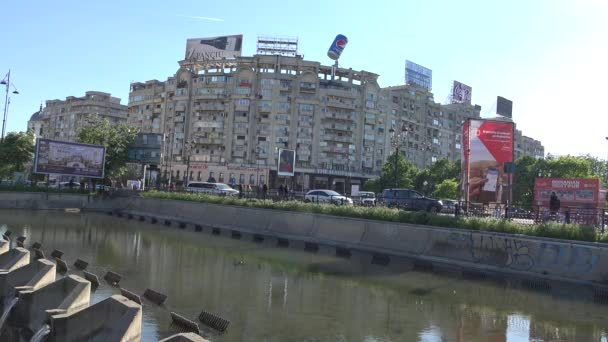 EDITORIAL Bucharest, Romania, Union Square - Circa April 2016 - Dam on Dambovita river,  traffic and poplar fluff, 4k, UHD