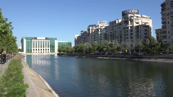 EDITORIAL Bucharest, Romania, Union Square - Circa April 2016 - Traffic on Dambovita river and younger taking selfie , 4k, UHD