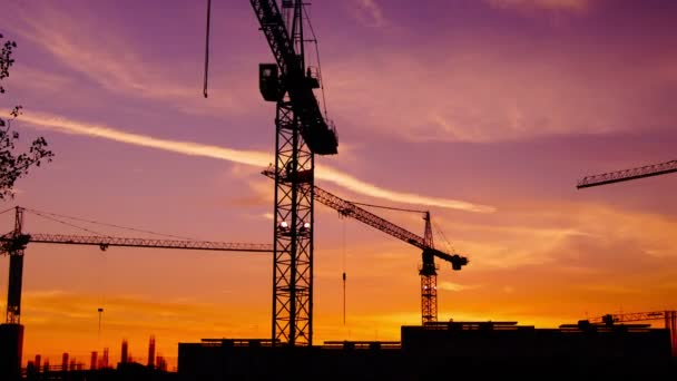 Time lapse  cranes working in construction site at dusk, time lapse, 4k,zoom out.Craner climbing