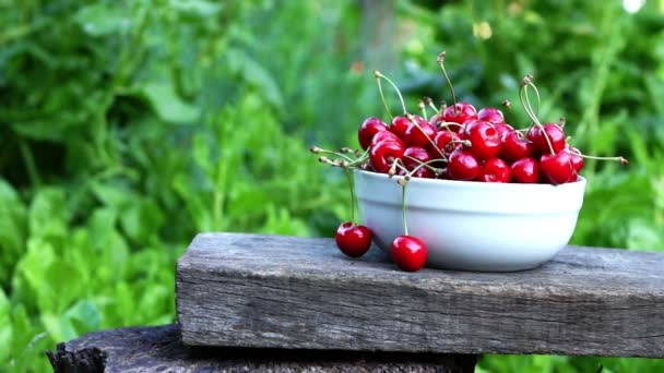 Cherries In A White Bowl. A Womans Hand Take One Cherry