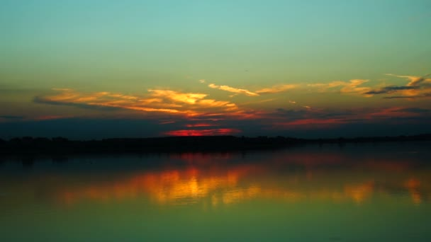 Beautiful sunset with  clouds mirror in water