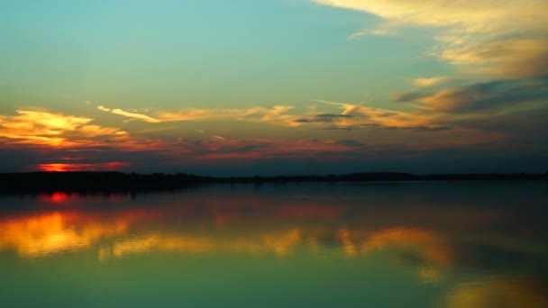 Beautiful sunset with  clouds mirror in water, pan