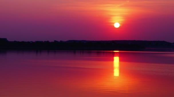 Sunset over lake, time lapse, 4k, tilt
