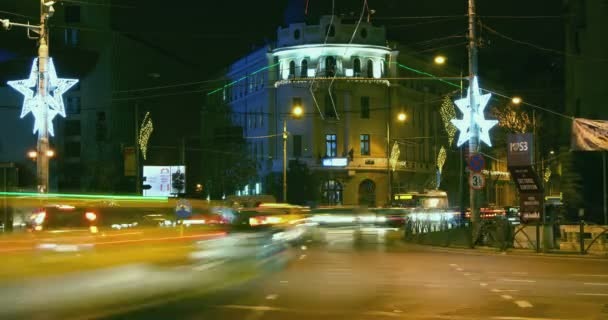 BUCHAREST - ROMANIA, December 2015, Night traffic  with car pass, Christmas decorations in Union Square. Static