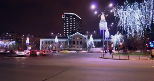 BUCHAREST - ROMANIA, December 2015, Night traffic  with car pass, Christmas decorations in Victory Square, zoom in