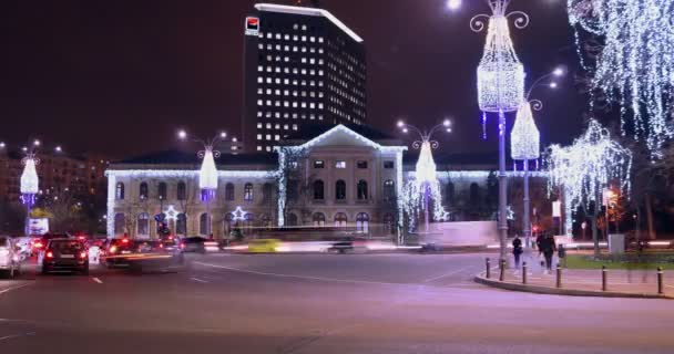 BUCHAREST - ROMANIA, December 2015, Night traffic  with car pass, Christmas decorations in Victory Square, zoom out