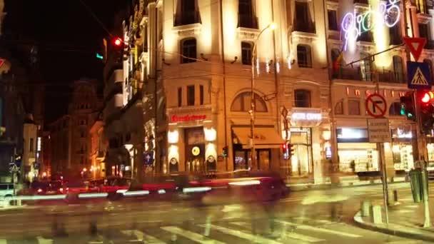 BUCHAREST, ROMANIA  - November 2015: Night traffic over queen Elizabeth Avenue  and Cismigiu Hotel, time  lapse,4k, Tilt