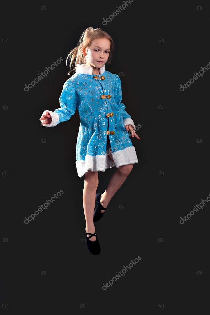 6e0041cb Little girl jumping in the air. In the blue dress. — Stock Photo ...