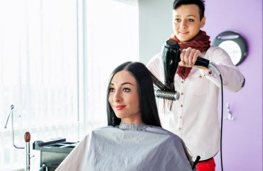 Spa. beauty saloon. Hairdresser makes styling
