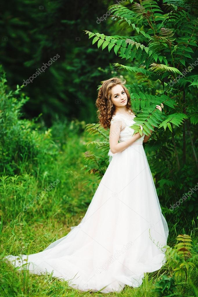 sweet girl in a dress the color of rose quartz — Stock Photo © y ...