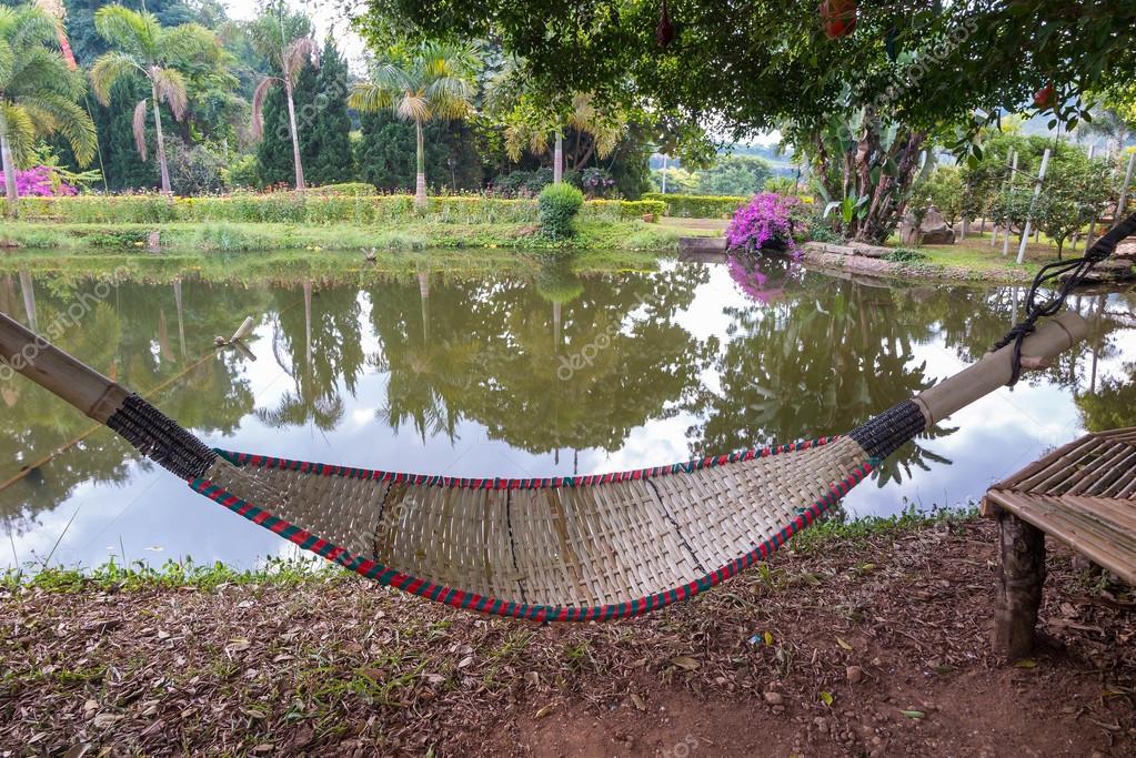 rattan bamboo hammock hanging on tree near the lake  u2014 stock photo  106299112 rattan bamboo hammock hanging on tree near the lake  u2014 stock photo      rh   depositphotos
