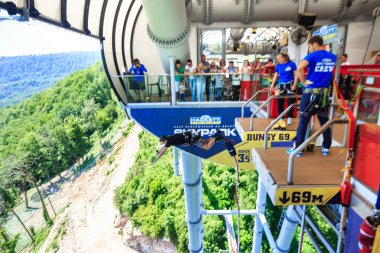 The man is jumping swallow type from 69 metres height, freestyle-bungy