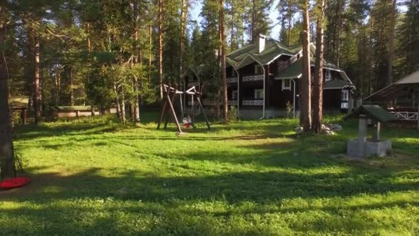 Aerial View. Mother and daughter swinging on a swing