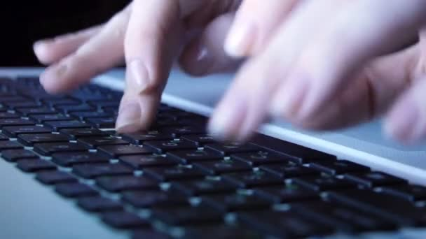 Femine hands typing on the keyboard of a laptop