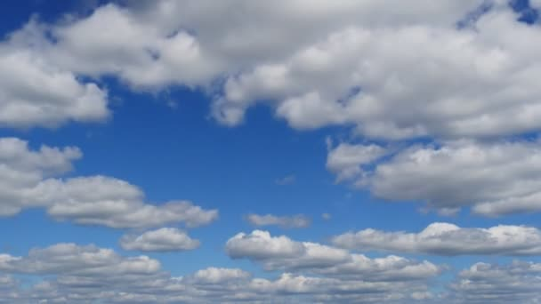Time-lapse clip of white fluffy clouds over blue sky on sunny day