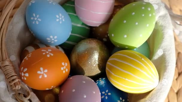 Happy Easter. Close up of painted eggs in a basket rotating in circle. POV.
