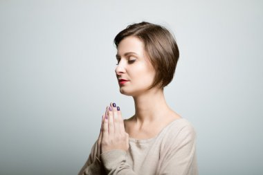 beautiful girl meditates in harmony, bright lifestyle photo, isolated on a gray background