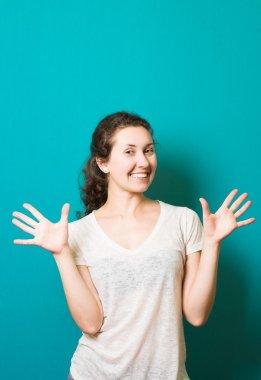 beautiful brunette girl showing surprise