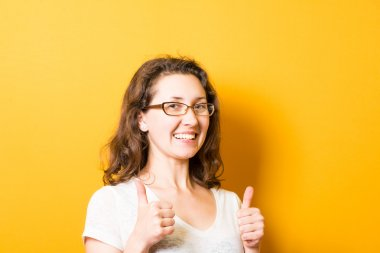 Funny girl showing thumbs up, everything is super cool