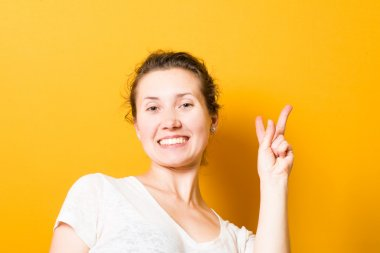 brunette beautiful girl showing two fingers, a sign of peace