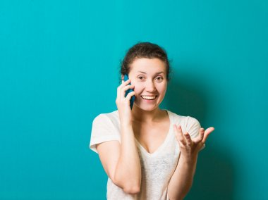 brunette beautiful girl surprised by phone