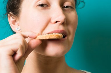 beautiful brunette girl eat cookie