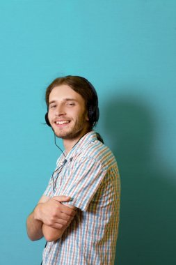 a young man wearing headphones listening to a presentation