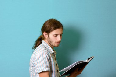 young man reading a diary
