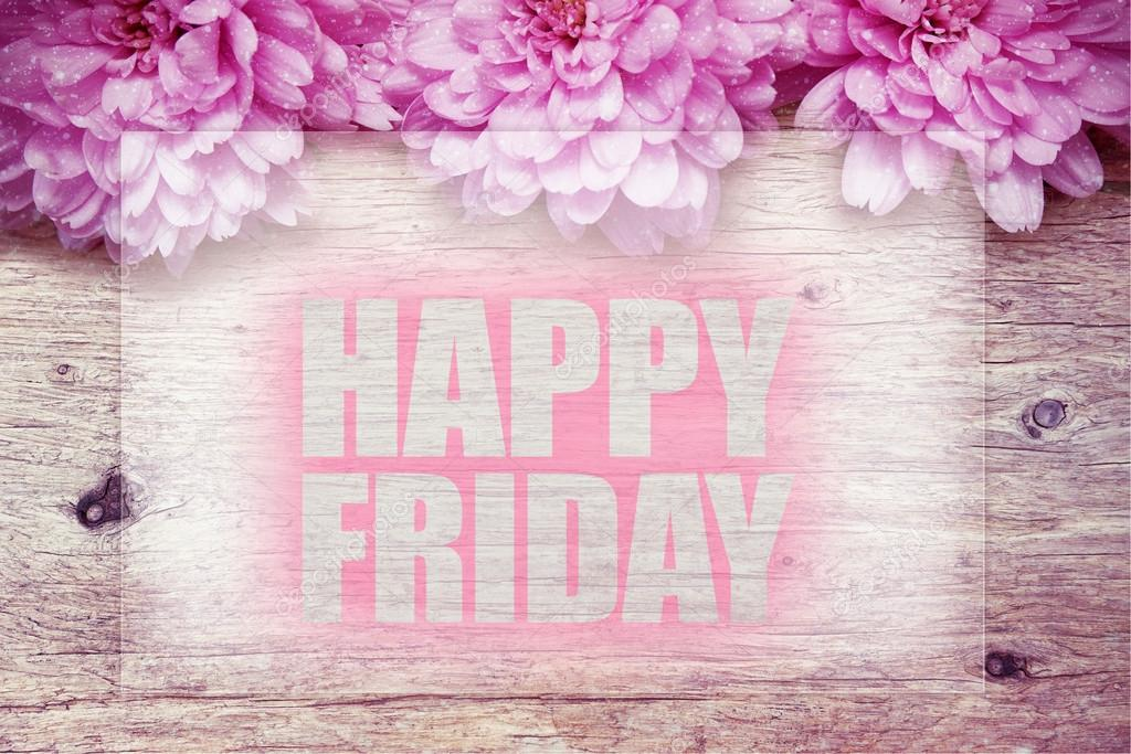 Pink Flowers On Wooden With Word Happy Friday Stock Photo