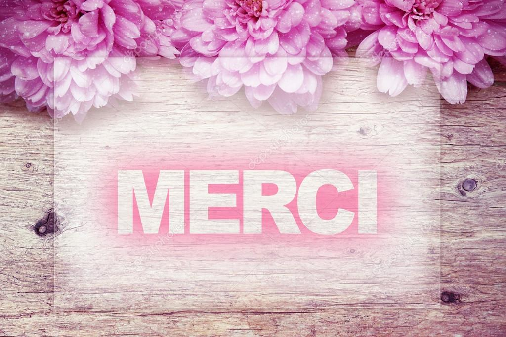 Pink flowers on wooden with word Merci french word — Stock Photo