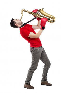 man saxophonist in  boxing gloves playing saxophone