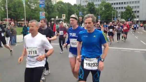 Berlin, Germany - April 2014 - Women and men of different ages run in the Berlin marathon