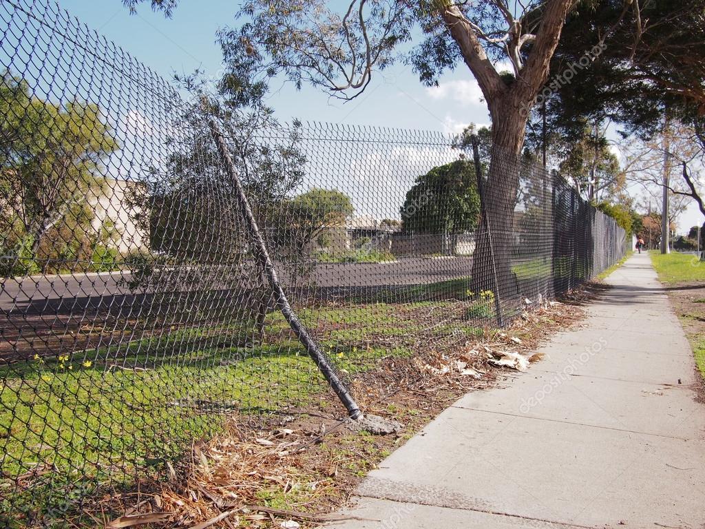 Damaged wire security fence — Stock Photo © Stringer_Image #120088488